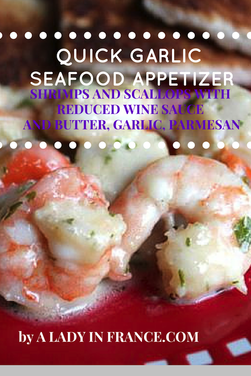 Quick Garlic-Seafood Appetizer with reduced wine sauce, butter and parmesan. By @aladyinfrance